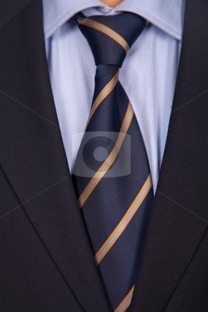 Man suit stock photo, Detail of a business man suit with blue tie by Rui Vale de Sousa