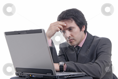 Working stock photo, Young bored man and working with is laptop by Rui Vale de Sousa