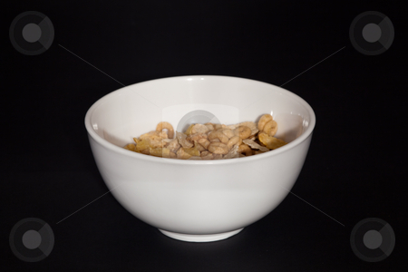 Bowl of cereal stock photo, Cereal grains are grown in greater quantities and provide more food energy worldwide than any other type of crop; they are therefore staple crops. In their natural form (as in whole grain), they are a rich source of vitamins, minerals, carbohydrates, fats and oils and protein. by Mariusz Jurgielewicz