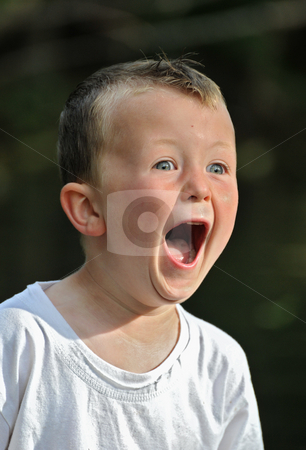Terrified little boy stock photo, Crying little boy in a white T shirt by Bonzami Emmanuelle