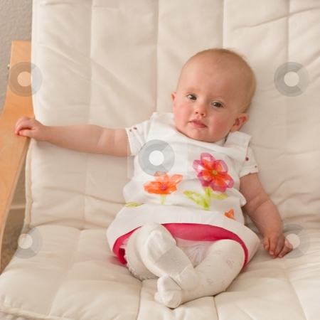 Little baby girl stock photo, Cute caucasian little baby girl sitting o a chair. by Mariusz Jurgielewicz