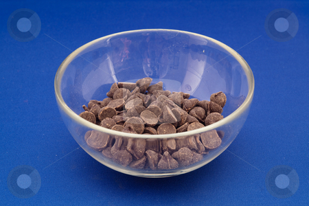 Chocolate chips stock photo, Chocolate chips are small chunks of chocolate. They are often sold in a round, flat-bottomed teardrop shape, and so are the chocolates. by Mariusz Jurgielewicz