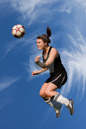 High header stock photo, Athletic female high in the air heading a soccer ball by Steve Mcsweeny