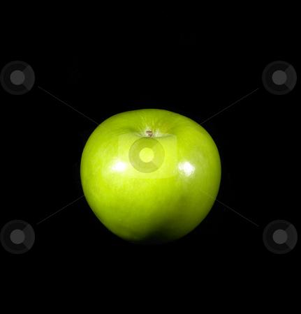 Green apple stock photo, Fresh vivid green apple over black background by Francesco Perre