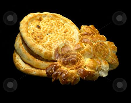 Uzbek bread stock photo, Original fresh uzbek bread isolated over black background by Francesco Perre