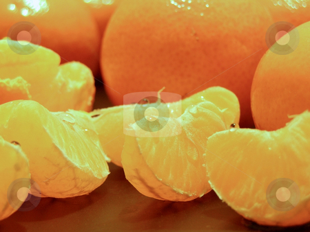Oranges stock photo, Composition of the pieces of orange against the whole oranges by Sergej Razvodovskij