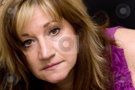 Middle Aged Woman stock photo, Portrait of a serious looking middle aged woman. by Todd Arena