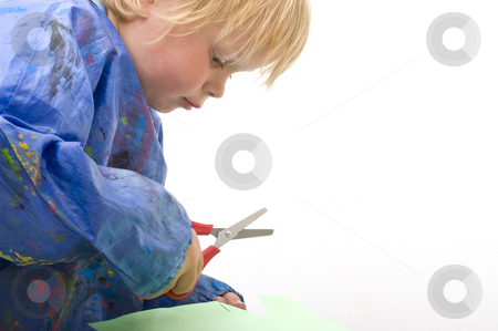 Cutting paper stock photo, Profile of a child cutting paper, with plenty of copyspace by Corepics VOF