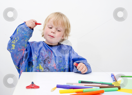 Idea stock photo, Young child getting an idea, ready to start his drawing by Corepics VOF