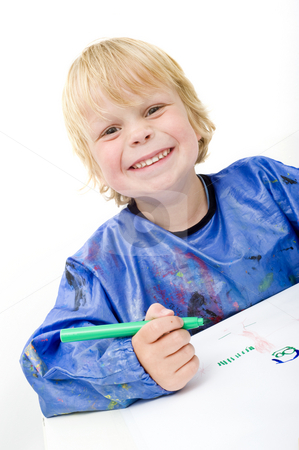 Cheerful kid stock photo, Cheerful kid with a broad smile and a felt pen in his hand making a drawing by Corepics VOF