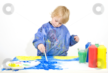 Young painter stock photo, Young child absorbed in painting with acrylic paint by Corepics VOF