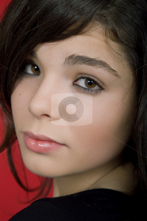 Close stock photo, Young woman portrait isolated on red background by Rui Vale de Sousa