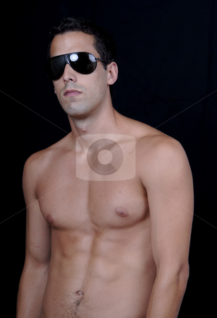 Sun glasses stock photo, Naked muscular male model with sun glasses by Rui Vale de Sousa