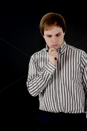 Sad stock photo, Sad young man portrait in a black background by Rui Vale de Sousa