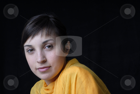 Woman stock photo, Beautiful young woman posing in black background by Rui Vale de Sousa