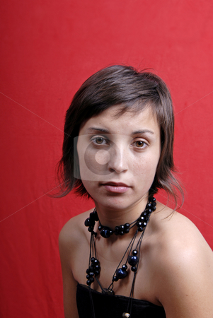 Girl stock photo, Young woman portrait isolated on red background by Rui Vale de Sousa
