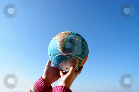 World stock photo, Small globe in a woman hands and the sky by Rui Vale de Sousa