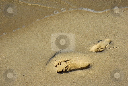 Footprint stock photo, Footprint in the sand and a wave by Rui Vale de Sousa