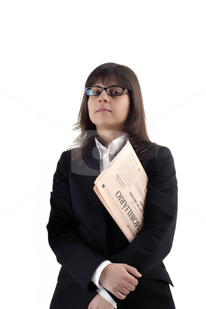 Woman stock photo, A business woman reading the financial newspaper by Rui Vale de Sousa