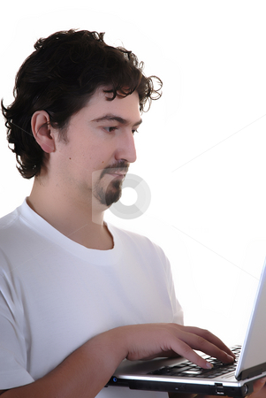 Working stock photo, Young man typing in the personal computer by Rui Vale de Sousa