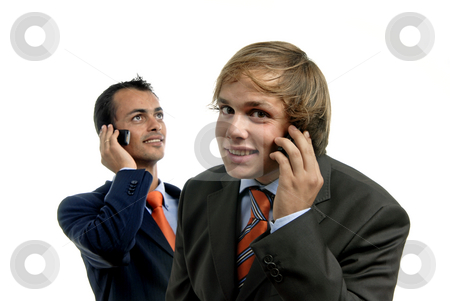 Calling stock photo, Two young business men on the phone by Rui Vale de Sousa