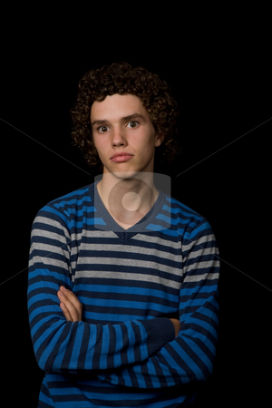 Serious stock photo, Young serious man portrait, on a black background by Rui Vale de Sousa