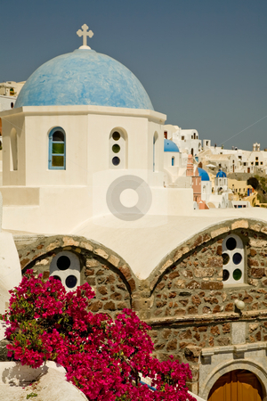 Flowers stock photo, Flowers and a church in Oia at the greek island of Santorini by Rui Vale de Sousa