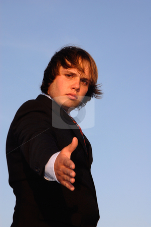 Offering stock photo, Young man offering hand in sunset light by Rui Vale de Sousa