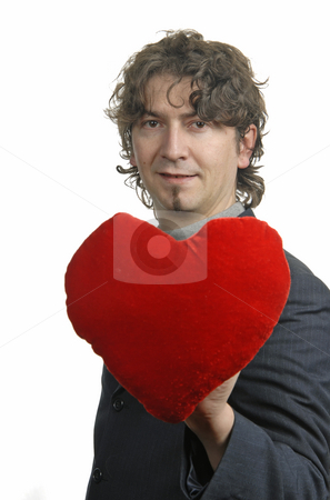 Heart stock photo, Man holding a red heart in the hand. On white background by Rui Vale de Sousa