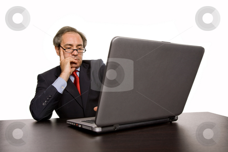 Working stock photo, Mature business man working with his laptop by Rui Vale de Sousa