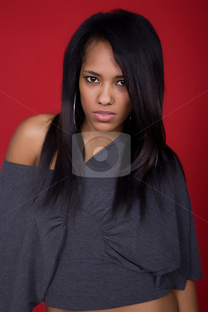Woman stock photo, Young casual woman portrait in a red background by Rui Vale de Sousa