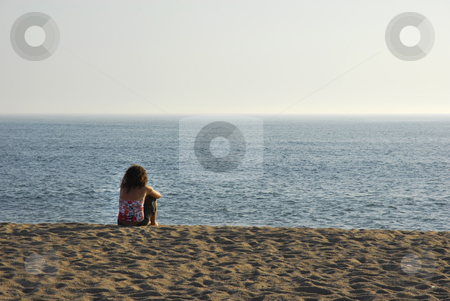 Relax stock photo, Young woman alone enjoying the sand at the beach by Rui Vale de Sousa