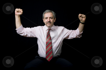 Victory stock photo, Mature business man portrait on black background by Rui Vale de Sousa