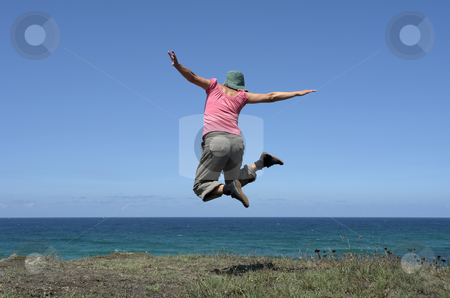Jump stock photo, Happy woman with a big jump at the coast by Rui Vale de Sousa