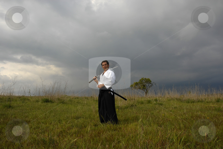 Fighter stock photo, Young aikido man with a sword outdoors by Rui Vale de Sousa