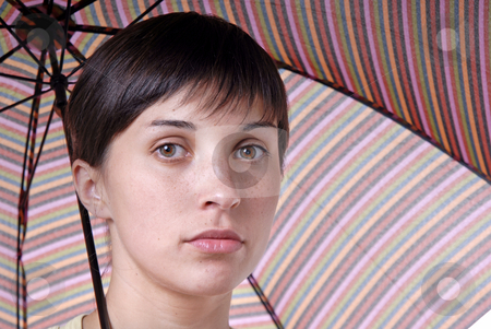 Brunette stock photo, Young brunette girl with umbrella in colors by Rui Vale de Sousa