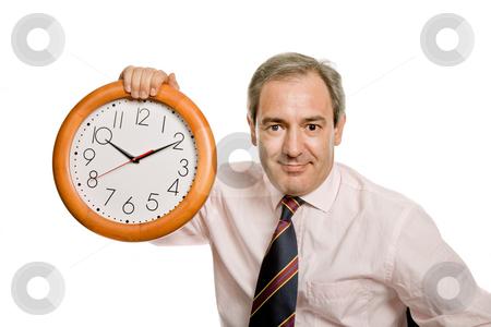 Clock stock photo, Mature handsome business man holding a clock by Rui Vale de Sousa