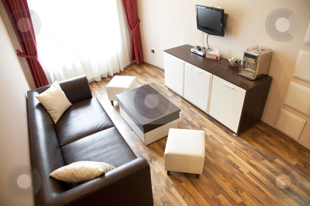 Hotel livingroom stock photo, Hotel room with red and beige four stars empty by Adrian Costea