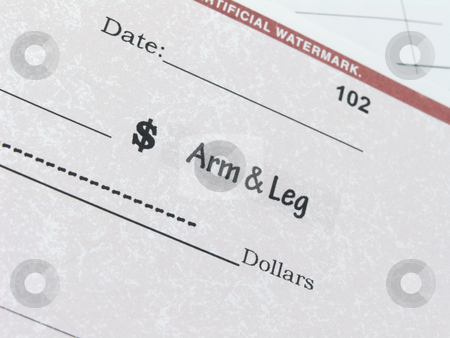 Conceptual check for an arm and leg stock photo, Close up of conceptual check for arm and leg by John Teeter