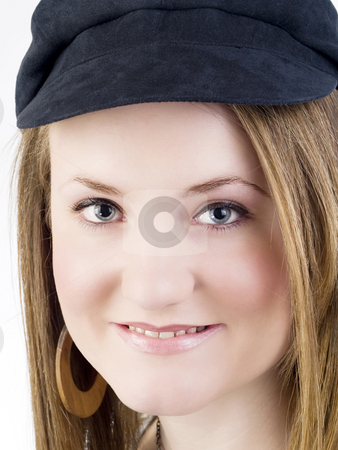 Closeup portrait of young caucasian woman in black hat stock photo, Closeup portrait of young woman with small smile by Jeff Cleveland
