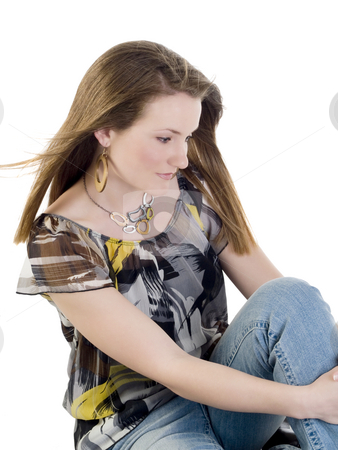 Young woman sitting on floor in jeans and blouse stock photo, Young caucasian woman sitting in jeans and blouse by Jeff Cleveland