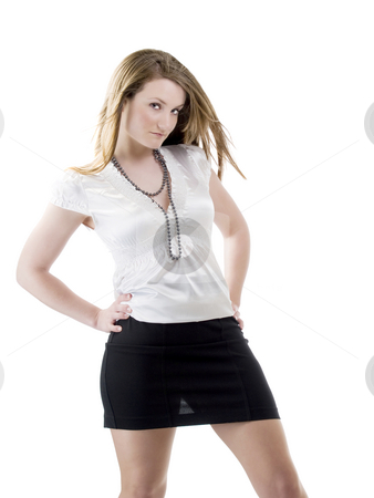 Young woman in white blouse and black skirt stock photo, Young caucasian slavik woman with arms on hips by Jeff Cleveland