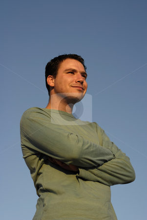 Silly stock photo, Silly face young man with sky as background in sunset light by Rui Vale de Sousa