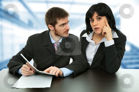 Workers stock photo, Young business couple working at the office by Rui Vale de Sousa