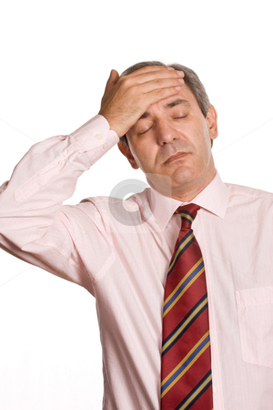 Headache stock photo, Businessman in a suit gestures with a headache by Rui Vale de Sousa
