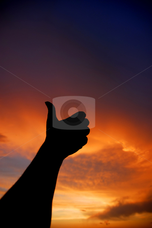 Thumb up stock photo, Human hand going thumbs up at sunset by Rui Vale de Sousa