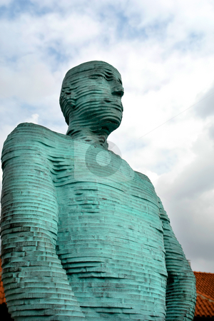 Statue stock photo, Green textured male statue in prague with clouds in the sky by Rui Vale de Sousa