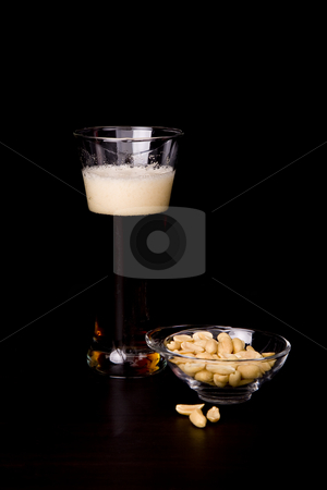 Beer stock photo, Cold beer glass and peanuts, studio picture by Rui Vale de Sousa