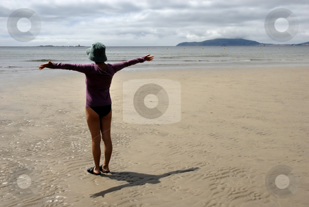 Happiness stock photo, Young woman in the beach with arms wide open by Rui Vale de Sousa