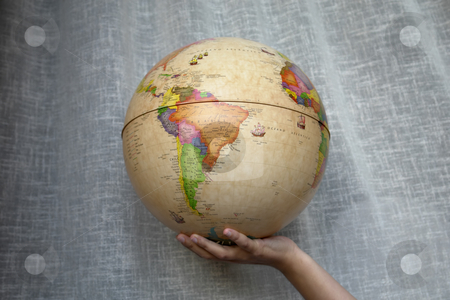Globe stock photo, World globe in a woman hand detail by Rui Vale de Sousa